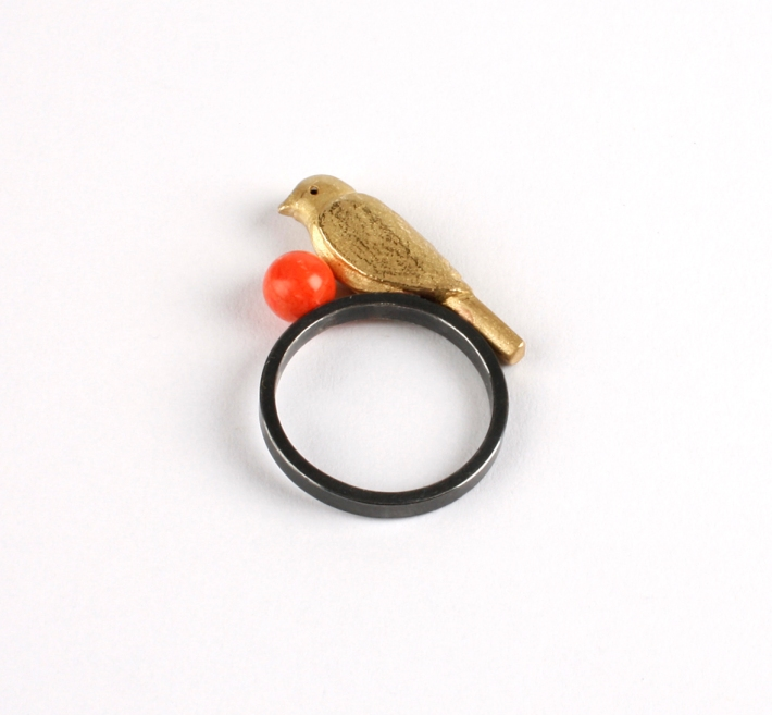 ring with red ball