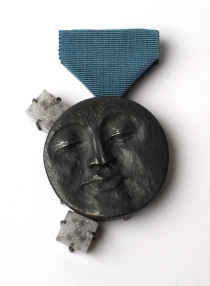 Man in the moon brooch